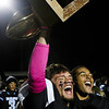 Cheyenne East players Christian Anderton (1) and Ox Schroeder (24) cheer with the Andy Bunten Jr. Memorial Trophy Friday, October 11, 2019 at Cheyenne East High School. The Cheyenne East High School Thunderbirds defeated the Cheyenne Central High School Indians 24-21. Nadav Soroker/Wyoming Tribune Eagle
