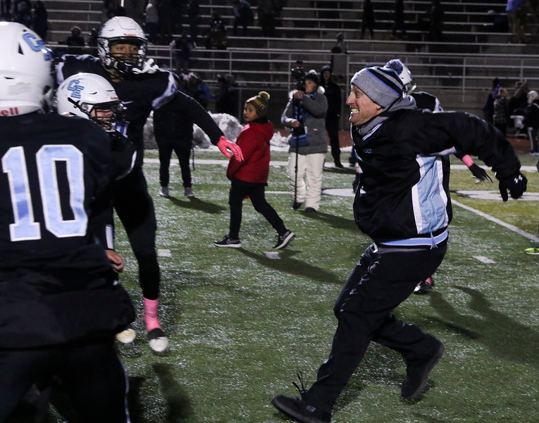 Cheyenne East head coach Chad Goff gets a running start before jumping into the team after their victory Friday, October 11, 2019 at Cheyenne East High School. The Cheyenne East High School Thunderbirds defeated the Cheyenne Central High School Indians 24-21. Nadav Soroker/Wyoming Tribune Eagle