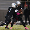 Cheyenne East quarterback Graedyn Buell (13) hands the ball off to running back Christian Anderton (1) Friday, October 11, 2019 at Cheyenne East High School. The Cheyenne East High School Thunderbirds defeated the Cheyenne Central High School Indians 24-21. Nadav Soroker/Wyoming Tribune Eagle