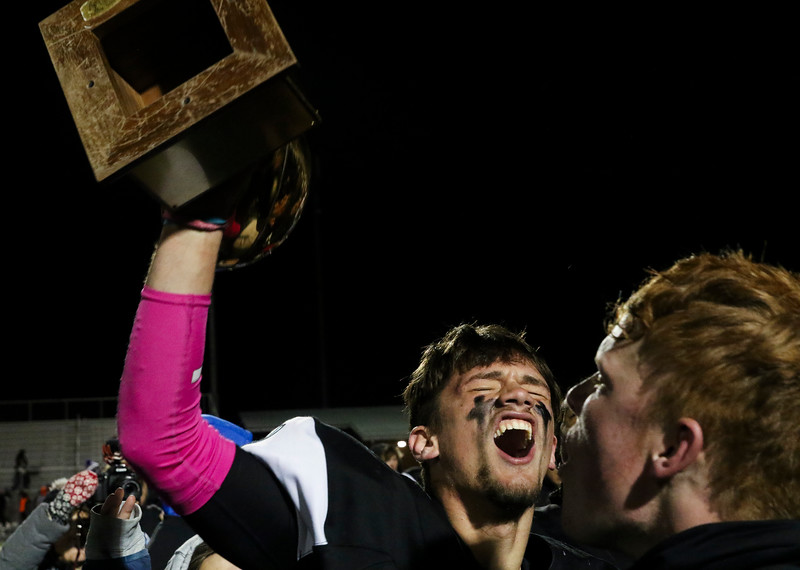 Cheyenne East players Christian Anderton (1) cheers with the Andy Bunten Jr. Memorial Trophy Friday, October 11, 2019 at Cheyenne East High School. The Cheyenne East High School Thunderbirds defeated the Cheyenne Central High School Indians 24-21. Nadav Soroker/Wyoming Tribune Eagle