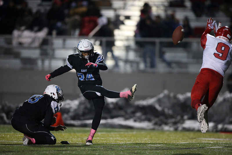 Cheyenne East kicker Ox Schroeder (24) launches an extra point attempt Friday, October 11, 2019 at Cheyenne East High School. The Cheyenne East High School Thunderbirds defeated the Cheyenne Central High School Indians 24-21. Nadav Soroker/Wyoming Tribune Eagle