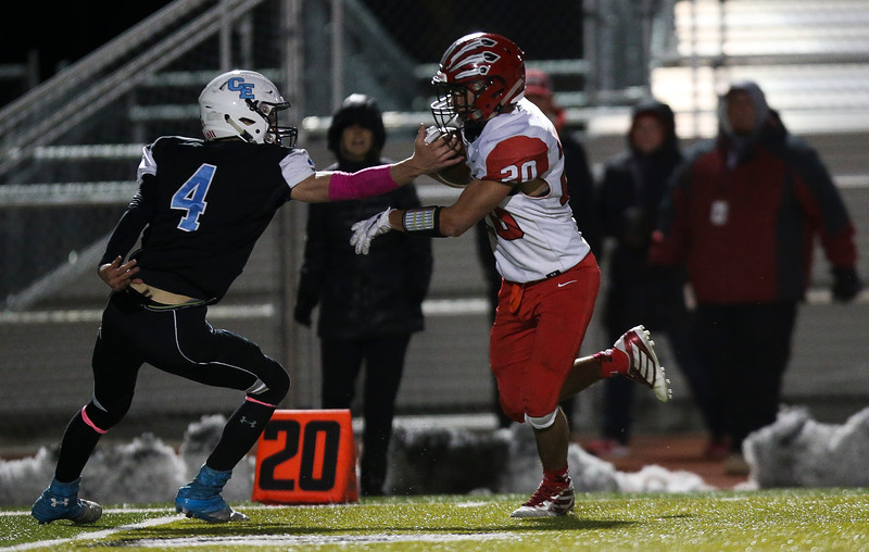 Cheyenne East defensive back Chance Aumiller (4) rips the ball from Cheyenne Central running back Carter Lobatos's (20) hand Friday, October 11, 2019 at Cheyenne East High School. The Cheyenne East High School Thunderbirds defeated the Cheyenne Central High School Indians 24-21. Nadav Soroker/Wyoming Tribune Eagle