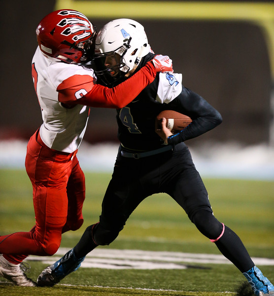Cheyenne East wider receiver Chance Aumiller (4) fights off Cheyenne Central defensive back Andrew Johnson (9) Friday, October 11, 2019 at Cheyenne East High School. The Cheyenne East High School Thunderbirds defeated the Cheyenne Central High School Indians 24-21. Nadav Soroker/Wyoming Tribune Eagle