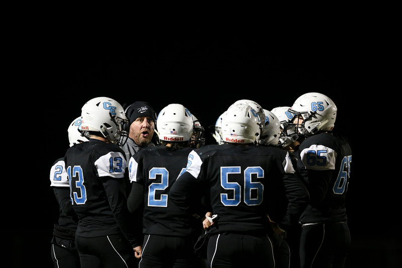 Cheyenne East assistant coach Kirk Nelson directs the team during a time out Friday, October 11, 2019 at Cheyenne East High School. The Cheyenne East High School Thunderbirds defeated the Cheyenne Central High School Indians 24-21. Nadav Soroker/Wyoming Tribune Eagle
