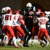Cheyenne East wide receiver Ox Schroeder (24) is hoisted into the air by Cheyenne Central defenders Friday, October 11, 2019 at Cheyenne East High School. The Cheyenne East High School Thunderbirds defeated the Cheyenne Central High School Indians 24-21. Nadav Soroker/Wyoming Tribune Eagle