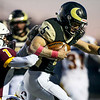 Cheyenne South quarterback Braeden Hughes (5) pushes through Laramie defensive back Janson Adair (1) Friday, October 11, 2019 at South High School. The Bison defeated the Laramie High School Plainsmen 36-35. Nadav Soroker/Wyoming Tribune Eagle