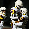 Laramie running back Isaac Sell (21) celebrates a touchdown with wide receivers Conner Killpack (33) and Travis Judd (5) Friday, October 11, 2019 at South High School. The Bison defeated the Laramie High School Plainsmen 36-35. Nadav Soroker/Wyoming Tribune Eagle