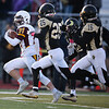 Laramie running back Isaac Sell (21) runs from a posse of Cheyenne South defenders Friday, October 11, 2019 at South High School. The Bison defeated the Laramie High School Plainsmen 36-35. Nadav Soroker/Wyoming Tribune Eagle