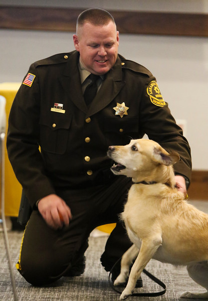Deputy Adam Wright holds back K-9 Teca as she barks during applause for award winners at the inaugural Salute to First Responders Banquet and Awards ceremony Saturday, October 12, 2019 at Laramie County Community College. Nadav Soroker/Wyoming Tribune Eagle