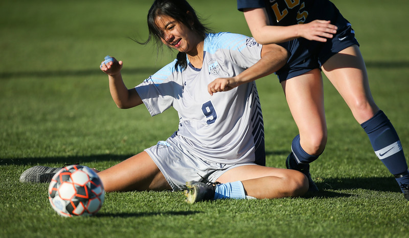 Otero player Adriana Caballero goes to the ground in a fight for the ball Saturday, October 12, 2019 at Laramie County Community College. The Laramie County Community College girls soccer team defeated the Otero Junior College team 3-0. Nadav Soroker/Wyoming Tribune Eagle