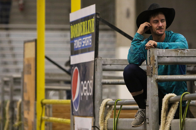 A cowboy relaxes on the chutes in the Shawn Dubie Memorial Rodeo Saturday, October 12, 2019 at the  Laramie County Community College Arena. Nadav Soroker/Wyoming Tribune Eagle