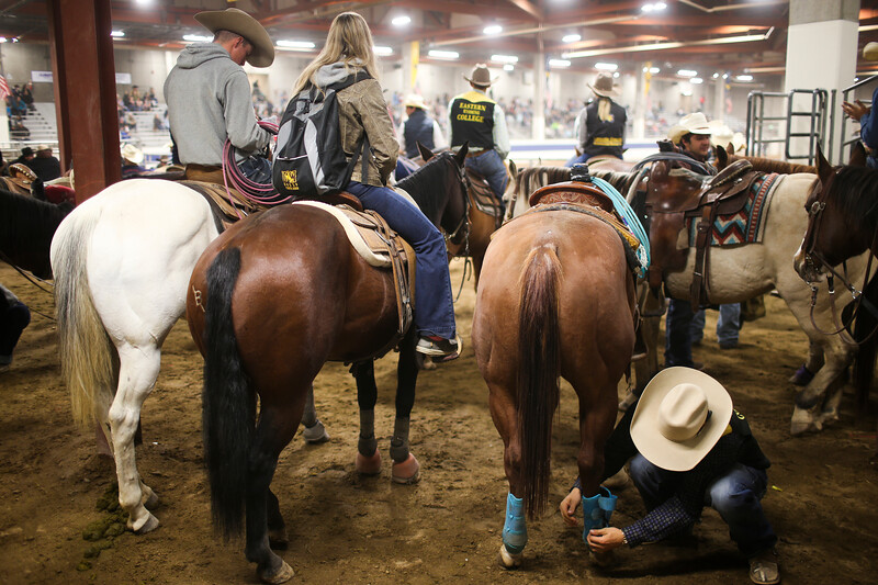Cowboys wait behind the chutes before the start of the Shawn Dubie Memorial Rodeo Saturday, October 12, 2019 at the  Laramie County Community College Arena. Nadav Soroker/Wyoming Tribune Eagle