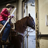 A cowgirl rides out of the arena building before the start of the Shawn Dubie Memorial Rodeo Saturday, October 12, 2019 at the  Laramie County Community College Arena. Nadav Soroker/Wyoming Tribune Eagle