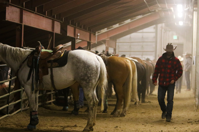 Gavin Duncan, from Sheridan, walks behind the chutes of the Shawn Dubie Memorial Rodeo Saturday, October 12, 2019 at the  Laramie County Community College Arena. Nadav Soroker/Wyoming Tribune Eagle