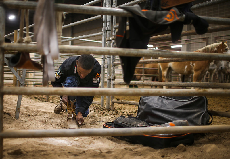 Rickey Williams prepares himself before the start of the Shawn Dubie Memorial Rodeo Saturday, October 12, 2019 at the  Laramie County Community College Arena. Williams rides bareback for Central Wyoming College in Riverton. Nadav Soroker/Wyoming Tribune Eagle