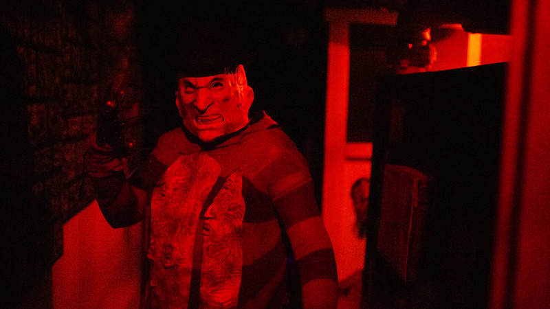 Michael Greene as Freddy Krueger strikes a pose in one of the Nightmare on 17th Street haunted house sets, Friday, Oct. 18, 2019 at the Knights of Pythias building. The haunted house is in its 31st year of scaring for charity. Nadav Soroker/Wyoming Tribune Eagle
