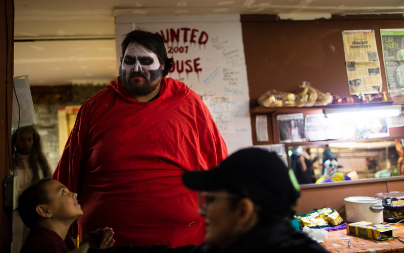 Nick Sconiers' as Otis from the House of 1000 Corpses hangs out behind the scenes of the Nightmare on 17th Street haunted house, Friday, Oct. 18, 2019 at the Knights of Pythias building. The haunted house is in its 31st year of scaring for charity. Nadav Soroker/Wyoming Tribune Eagle