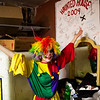 Corbin Hayes shows off her finished clown ensemble behind the scenes of the Nightmare on 17th Street haunted house, Friday, Oct. 18, 2019 at the Knights of Pythias building. The haunted house is in its 31st year of scaring for charity. Nadav Soroker/Wyoming Tribune Eagle