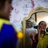 Corbin Hayes puts on her makeup as a clown behind the scenes of the Nightmare on 17th Street haunted house, Friday, Oct. 18, 2019 at the Knights of Pythias building. The haunted house is in its 31st year of scaring for charity. Nadav Soroker/Wyoming Tribune Eagle