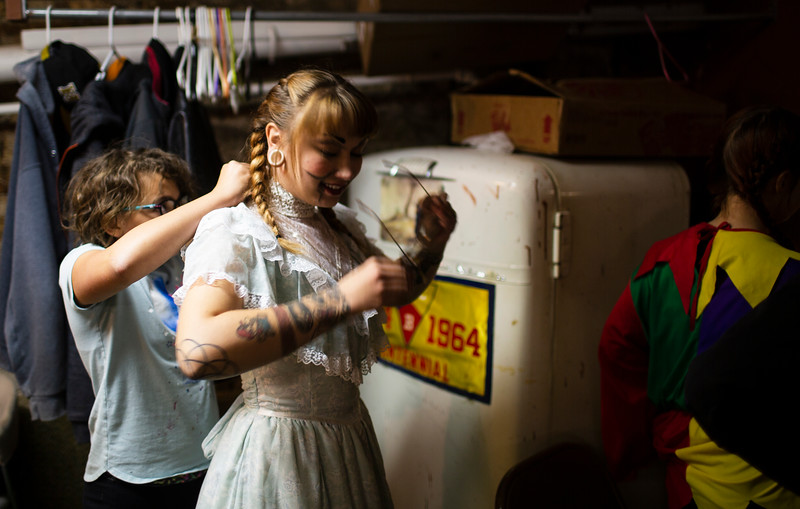 A volunteer fixes Gemini Mathew's Annabelle dress behind the scenes of the Nightmare on 17th Street haunted house, Friday, Oct. 18, 2019 at the Knights of Pythias building. The haunted house is in its 31st year of scaring for charity. Nadav Soroker/Wyoming Tribune Eagle