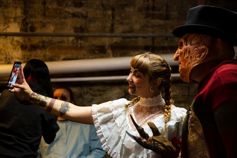 Gemini Mathew's as Annabelle and Michael Greene as Freddy Krueger take a selfie behind the scenes of the Nightmare on 17th Street haunted house, Friday, Oct. 18, 2019 at the Knights of Pythias building. The haunted house is in its 31st year of scaring for charity. Nadav Soroker/Wyoming Tribune Eagle