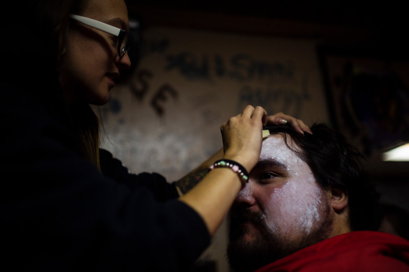 Aspen Duran does Nick Sconiers' makeup as Otis from the House of 1000 Corpses behind the scenes of the Nightmare on 17th Street haunted house, Friday, Oct. 18, 2019 at the Knights of Pythias building. The haunted house is in its 31st year of scaring for charity. Nadav Soroker/Wyoming Tribune Eagle