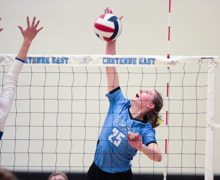 East junior Ashley Marshall (25) spikes the ball over the net Saturday, Oct. 19, 2019 at the Thunderdome. The Cheyenne East High School Lady Thunderbirds volleyball lost to the Thunder Basin Lady Bolts in four sets. Nadav Soroker/Wyoming Tribune Eagle