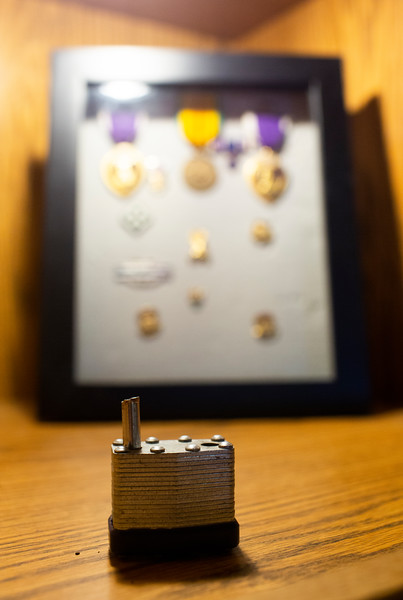The broken lock from the Fleet Reserve Association trailer is posed in this photo illustration near a shadow box similar to the one that was broken into and stolen from Monday, Oct. 21, 2019 at VFW Post 1881. Nadav Soroker/Wyoming Tribune Eagle