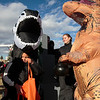 Kayleb Krog, 6, a skeleton dinosaur, trick or treats for candy from Tempest Johnson, a fleshy dinosaur, at the Pride Consulting booth at the Cheyenne Small Business Trunk or Treat Thursday, Oct. 24, 2019 on Wallick Road. Nadav Soroker/Wyoming Tribune Eagle