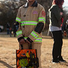 Joseph Urbina, 12, a firefighter, waits in line for candy at the Cheyenne Small Business Trunk or Treat Thursday, Oct. 24, 2019 on Wallick Road. Nadav Soroker/Wyoming Tribune Eagle