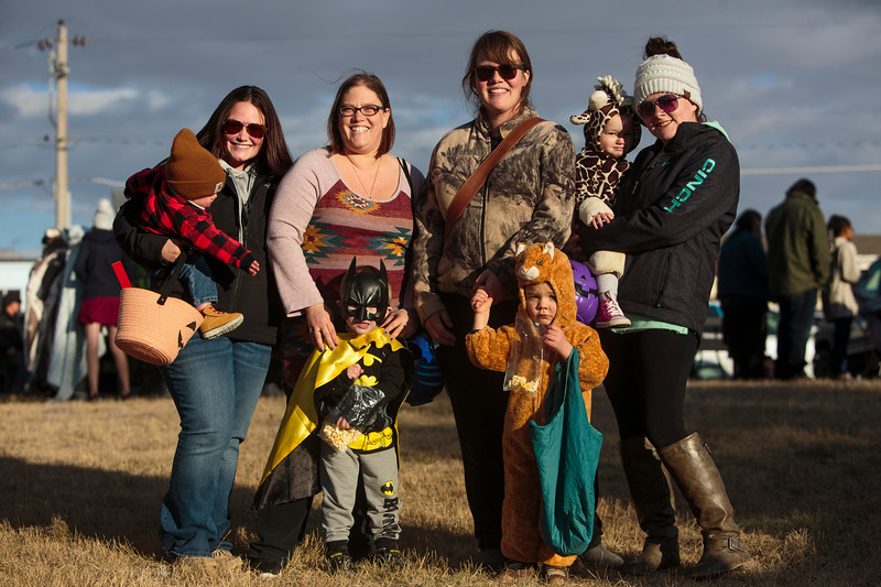 Elizabeth DeWitt and Elijah DeWitt, 1, Jennifer Ennis and Christopher Ennis, 3, Rebecca Smith and Henry Smith, 3, and Carson Long and Briar Long, 2, from the MOMS club of Cheyenne pose for a photo after going through the Cheyenne Small Business Trunk or Treat Thursday, Oct. 24, 2019 on Wallick Road. Nadav Soroker/Wyoming Tribune Eagle