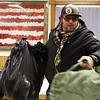 """Christopher """"Chewy"""" Jurceka grabs cold-weather gear at the Cheyenne Homeless Veterans Stand Down Thursday, Oct. 24, 2019 at American Legion Post 6. The Stand Down offers surplus gear like clothing, sleeping bags and cold-weather jackets from the Department of Defense to veterans to make sure they are ready for the winter. Nadav Soroker/Wyoming Tribune Eagle"""