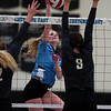 East senior Madison Blaney (12) tries to hit the ball past South junior Riley VanTassell (9) Thursday, Oct. 24, 2019 in the Thunderdome. Cheyenne East volleyball defeated Cheyenne South in straight sets. Nadav Soroker/Wyoming Tribune Eagle