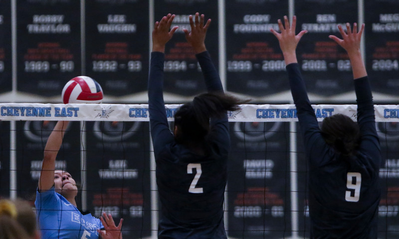 East senior Erianna Standifer (5) tries to hit the ball past South blockers Calysta Martinez (2) and Riley VanTassell (9) Thursday, Oct. 24, 2019 in the Thunderdome. Cheyenne East volleyball defeated Cheyenne South in straight sets. Nadav Soroker/Wyoming Tribune Eagle
