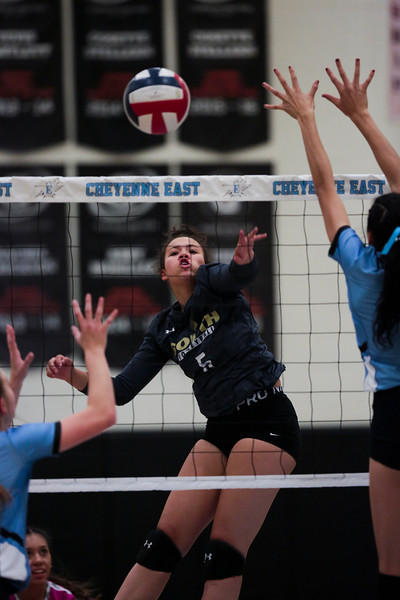 South sophomore Kayla Lesh (5) spikes the ball past East blockers Thursday, Oct. 24, 2019 in the Thunderdome. Cheyenne East volleyball defeated Cheyenne South in straight sets. Nadav Soroker/Wyoming Tribune Eagle