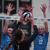 South junior Arianna Stensass (7) tries to hit the ball past East blockers Thursday, Oct. 24, 2019 in the Thunderdome. Cheyenne East volleyball defeated Cheyenne South in straight sets. Nadav Soroker/Wyoming Tribune Eagle