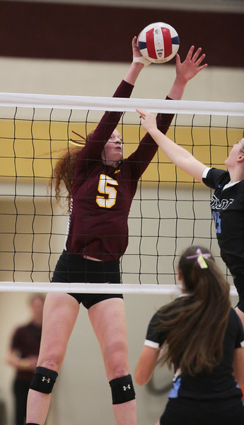 Laramie sophomore Alexis Stucky (5) blocks an attack from Cheyenne East Friday, Oct. 25, 2019 at the Laramie High School Gymnasium. The Laramie High School Lady Plainsmen host the Cheyenne East High School Lady Thunderbirds. Nadav Soroker/Laramie Boomerang