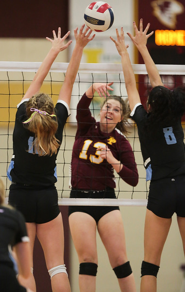 Laramie sophomore Morgann Jensen (13) tries to attack through Cheyenne East blockers Friday, Oct. 25, 2019 at the Laramie High School Gymnasium. The Laramie High School Lady Plainsmen host the Cheyenne East High School Lady Thunderbirds. Nadav Soroker/Laramie Boomerang