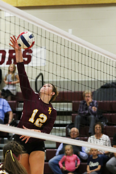 Laramie senior Jessica Crane (12) hits the ball Friday, Oct. 25, 2019 at the Laramie High School Gymnasium. The Laramie High School Lady Plainsmen host the Cheyenne East High School Lady Thunderbirds. Nadav Soroker/Laramie Boomerang