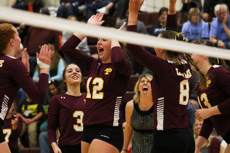 Laramie senior Jessica Crane (12) celebrates a point with her teammates Friday, Oct. 25, 2019 at the Laramie High School Gymnasium. The Laramie High School Lady Plainsmen host the Cheyenne East High School Lady Thunderbirds. Nadav Soroker/Laramie Boomerang