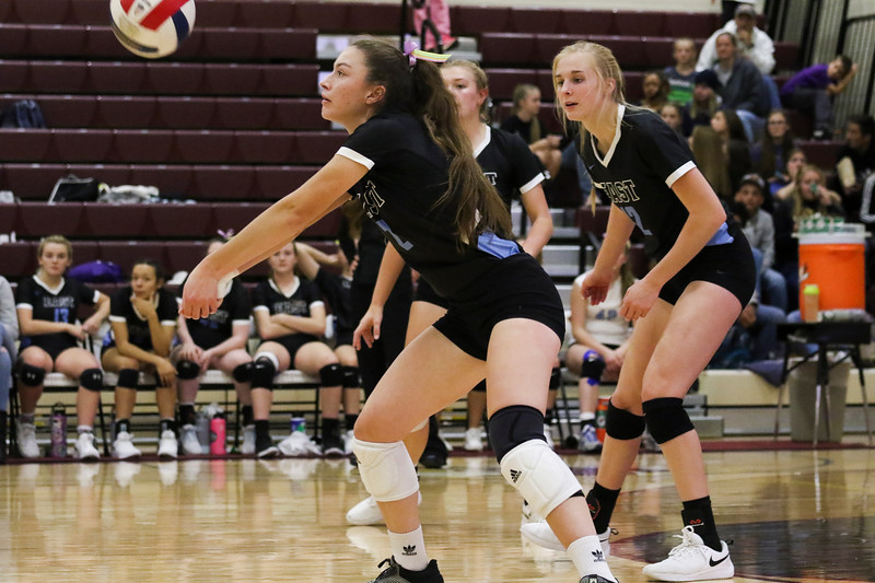 Cheyenne East senior Shae Halls (2)receives a serve Friday, Oct. 25, 2019 at the Laramie High School Gymnasium. The Laramie High School Lady Plainsmen host the Cheyenne East High School Lady Thunderbirds. Nadav Soroker/Laramie Boomerang