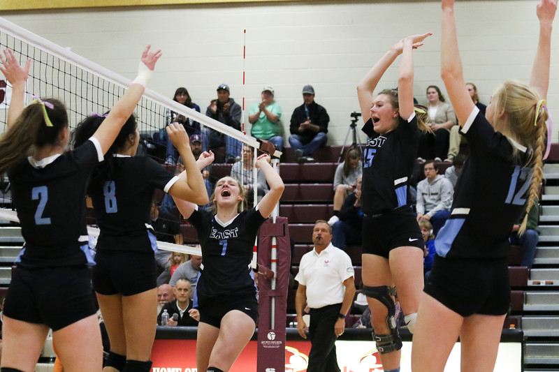 Cheyenne East players cheer a point Friday, Oct. 25, 2019 at the Laramie High School Gymnasium. The Laramie High School Lady Plainsmen host the Cheyenne East High School Lady Thunderbirds. Nadav Soroker/Laramie Boomerang
