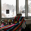A man walks by in the blowing snow, while inside a colorful Ofrenda waits for community members to add tokens of remembrance Tuesday, Oct. 29, 2019 in the Cheyenne Botanic Gardens. The Gardens have several ofrendas set up, two with tokens from Cheyenne's significant Latino and Latina members, and the on shown which is open for visitors to add to. Nadav Soroker/Wyoming Tribune Eagle
