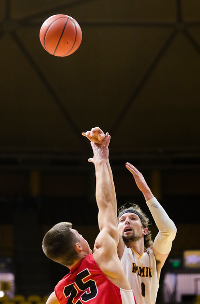 Wyoming's Jake Hendricks shoots the ball Wednesday, Oct. 30, 2019 at Arena-Auditorium. The Wyoming Cowboys basketball team hosts the Northwest Nazarene Nighthawks for an exhibition match. Nadav Soroker/Laramie Boomerang