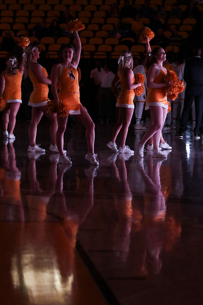 Wyoming cheer leaders wait to introduce the basketball team at the opening exhibition match Wednesday, Oct. 30, 2019 at Arena-Auditorium. The Cowboys defeated the Northwest Nazarene Nighthawks 62-56 in their exhibition game. Nadav Soroker/Laramie Boomerang