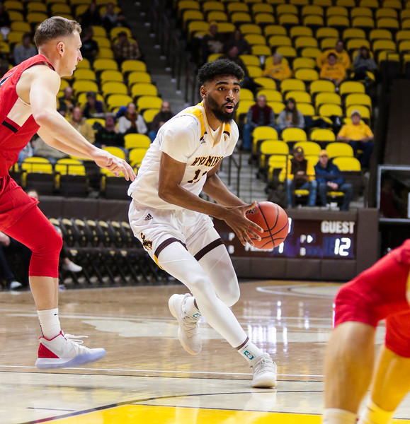 Wyoming's Trevon Taylor dribbles around a Nazarene defender Wednesday, Oct. 30, 2019 at Arena-Auditorium. The Wyoming Cowboys basketball team hosts the Northwest Nazarene Nighthawks for an exhibition match. Nadav Soroker/Laramie Boomerang