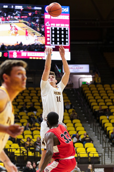 Wyoming's Hunter Thompson shoots the ball Wednesday, Oct. 30, 2019 at Arena-Auditorium. The Wyoming Cowboys basketball team hosts the Northwest Nazarene Nighthawks for an exhibition match. Nadav Soroker/Laramie Boomerang