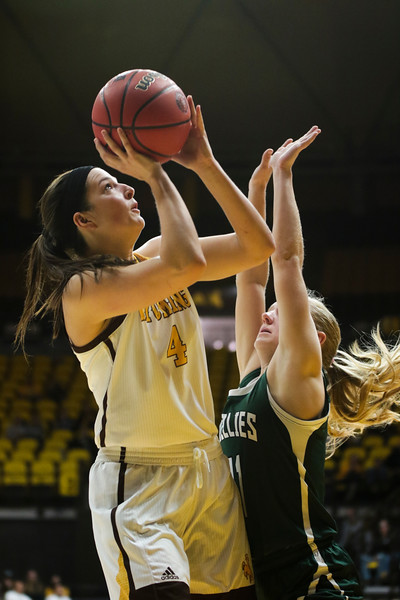 Cowgirls' Taylor Rusk looks for her shot Friday, Nov. 1, 2019 at Arena-Auditorium. The Wyoming Cowgirls host the Adams State Grizzlies for the season's opening exhibition match. Nadav Soroker/Laramie Boomerang