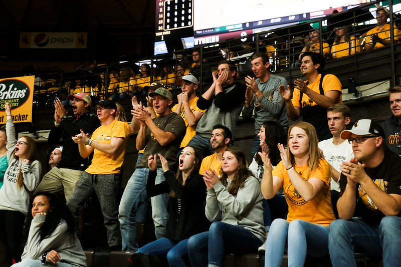 Cowgirls' fans cheer after a successful point Friday, Nov. 1, 2019 at Arena-Auditorium. The Wyoming Cowgirls host the Adams State Grizzlies for the season's opening exhibition match. Nadav Soroker/Laramie Boomerang