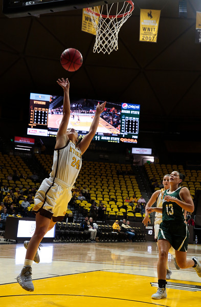 Cowgirls' Tommi Olson attempts a layup Friday, Nov. 1, 2019 at Arena-Auditorium. The Wyoming Cowgirls host the Adams State Grizzlies for the season's opening exhibition match. Nadav Soroker/Laramie Boomerang